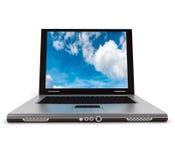 Bärbar dator i molnet Arkivfoto