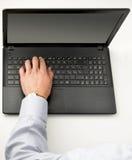 Bärbar dator med bästa sikt för hand Fotografering för Bildbyråer