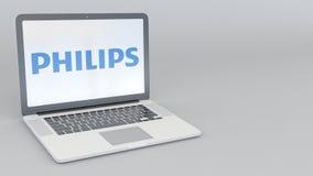 Bärbar dator med den Philips logoen Tolkning för ledare 3D för datateknik begreppsmässig Royaltyfria Foton