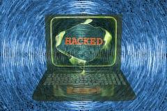 Bärbar dator med hackat ord Arkivbilder
