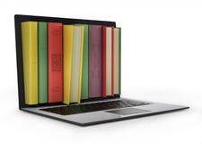 Bärbar dator och färgrik bok. Arkivfoton