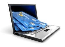 Bärbar dator och kreditkortar (den inklusive snabba banan) Arkivbild