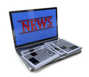 Bärbar dator och nyheterna Arkivfoto