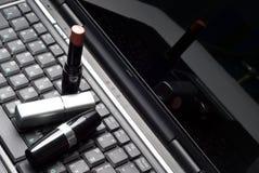 bärbar datorläppstift tre royaltyfri bild