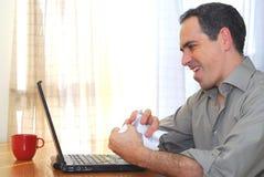 bärbar datorman arkivfoto