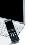 bärbar datormobiltelefon Arkivbilder