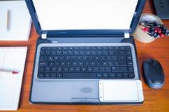bärbar datorsmartphone Fotografering för Bildbyråer