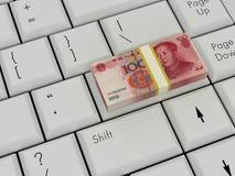 Bärbar datortangentbord med kinesiska pengar arkivfoto