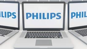 Bärbara datorer med den Philips logoen på skärmen Tolkning för ledare 3D för datateknik begreppsmässig Arkivfoto