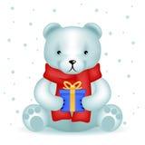 Bärenjunges sitzen mit Neujahrsgeschenkwinterhintergrund Lizenzfreie Stockfotografie