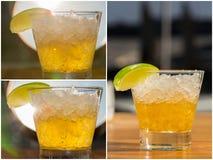 Bärnstensfärgad coctail i ett exponeringsglas på restauranen fotografering för bildbyråer