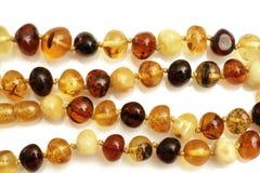 Bärnstensfärgade smycken Royaltyfri Bild