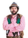 Bärtiger bayerischer Mann mit Rohr Stockfotografie