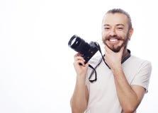 Bärtiger Mann mit einer Digitalkamera Lizenzfreies Stockfoto