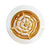 Bästa sikt av den isolerade varma koppen för cappuccino för kaffekaramellmacchiato Fotografering för Bildbyråer