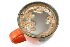 Bästa sikt av den röda koppen av svart kaffe Arkivfoto