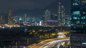 Bästa sikt av den upptagna trafiknatten i stads- timelapse för finans, Hong Kong stad arkivfilmer