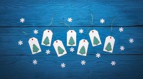 Bästa sikt av etiketter för tomt papper med julgranar Arkivbild