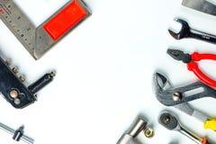 Bästa sikt av funktionsdugliga hjälpmedel, skiftnyckel, hålighetskiftnyckel, hammare som är screwdrive Arkivfoto