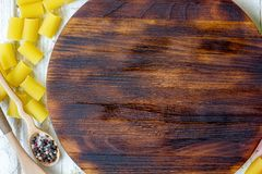 Bästa sikt av skärbrädan med pasta och grönsaker omkring med stället för din text Fotografering för Bildbyråer