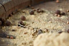 Bästa sikt av träskedar mycket av paprica och svartpeppar på trätrummabakgrund, selektiv fokus Fotografering för Bildbyråer