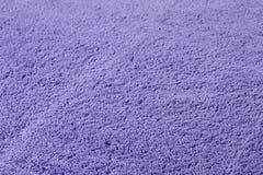 Bästa sikt för grov purpurfärgad textur arkivfoto