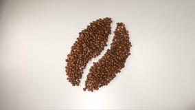 BÄSTA SIKT: Symbol för kaffeböna från bönor för ett kaffe på en vit bakgrund Arkivbilder