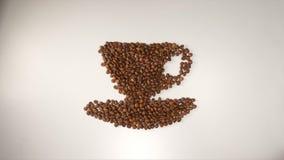 BÄSTA SIKT: Symbol för kaffekopp från bönor för ett kaffe på en vit bakgrund Arkivfoton