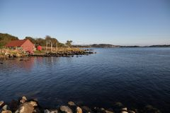 Båthus. Quiet afternoon by the sea with some boats Stock Photography