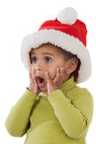 Bébé étonné avec le chapeau rouge de Noël Images stock