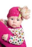 Bébé adorable avec la fleur d'isolement sur le fond blanc. Photos libres de droits