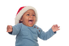 Bébé africain adorable avec des cris de chapeau de Noël images libres de droits