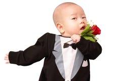 Bébé asiatique dans le smoking Photographie stock