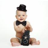 Bébé avec l'appareil-photo Photographie stock