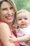 Bébé avec la maman Photos libres de droits