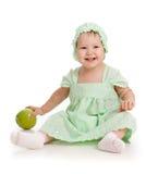 Bébé avec la pomme verte (nourriture saine) Images libres de droits