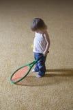 Bébé avec la raquette de tennis Photos libres de droits