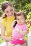 Bébé avec le récepteur de téléphone Photographie stock libre de droits