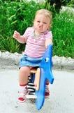 Bébé avec le visage drôle Photos stock