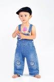 Bébé avec un ferraillement Image stock