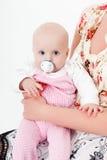 Bébé avec un pacificateur photo libre de droits