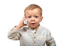 Bébé avec un téléphone portable photos stock