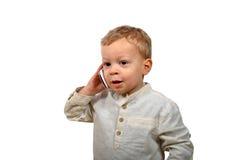 Bébé avec un téléphone portable photo stock