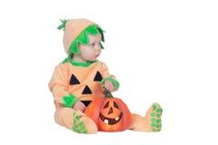 Bébé blond dans le costume de potiron Photo libre de droits