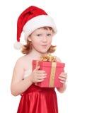 Bébé dans la fixation du chapeau de Santa son présent Photographie stock