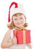 Bébé dans la fixation du chapeau de Santa son présent Photographie stock libre de droits