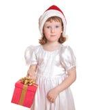 Bébé dans la fixation du chapeau de Santa son présent Photo libre de droits