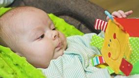 Bébé dans la poussette image libre de droits