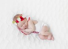 Bébé dans le bandeau coloré lumineux Photos libres de droits