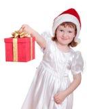 Bébé dans le cadre de cadeau de fixation du chapeau de Santa Images libres de droits